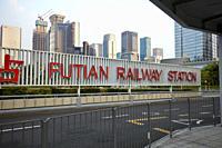 Futian railway station and high-rise buildings of Futian CBD. Shenzhen, Guangdong Province, China.