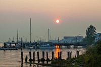 Evening sun struggling to penetrate the forest fire smoke over Steveston, British Columbia.