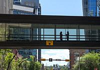 Canada, Alberta, Calgary. Elevated walkway between office towers in the downtown core. Called plus fifteen, as it is 15 ft above the ground.