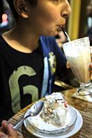 Sugar addiction- child eats ice cream and drinks milk shake.