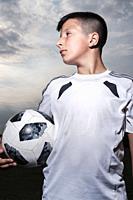 Boy-10-11 years old in football kit,Surrey,UK.