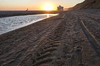 Last swimmers close to Chiringuito beach at sunset, Costa de la Luz seashore, Matalascanas, Huelva. Sunset.