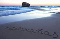 Matalacanas beach during the magnificent sunrise. Over the sand is written the name. Huelva, Spain.