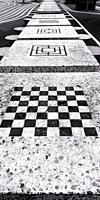 Chessboard and line of games tables, Superkilen, Norrebro, Copenhagen, Denmark Scandinavia. Superkilen is an urban development designed to celebrate d...
