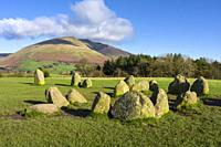 The ancient Castlerigg Stone Circle with Blencathra fell beyond in the English Lake District National Park, Cumbria, England.