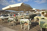View to the open-air restaurant by the sea in Parikia, Paros, Cyclades Islands, Greek Islands, Greece, Europe