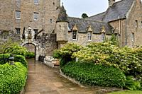 Front of Cawdor Castle with drawbridge bell and Stags Head Buckel Be Mindfull emblem in the rain Cawdor Nairn Scotland UK.