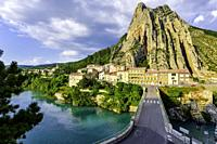 Sisteron and its rock, Provence, France, riverside of Durance with houses.