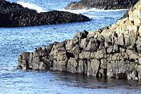 downfaulted basalt rock layers part of the county antrim coastline at Ballintoy county antrim northern ireland.