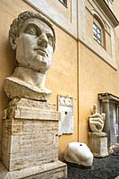 The head and hand of the Colossus of Constantine in the courtyard of the Palazzo dei Conservatori, part of the Capitoline Museums, Rome, Italy.