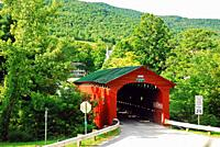 A covered bridge in the countryside of Vermont.