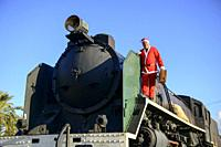 Man in Santa outfit on old locomotive