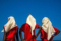 muslim high school girls in schooluniform at the beach at Kenya