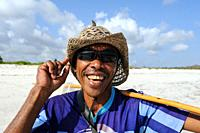 Lombok, West Nusa Tenggara, Indonesia, Asia - A local fisherman on Tanjung Aan Beach near the small town of Kuta in South Lombok.