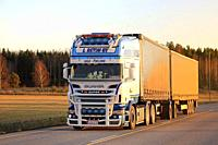 Salo, Finland - November 18, 2018: Customized super Scania R500 truck of L Retva Oy transports goods along highway at sunset time in autumn.