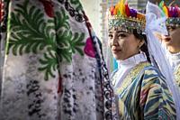 women in traditional dress, for folk dance, dancer, in Rukhobod Mausoleum, Samarkand, Uzbekistan.