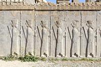 Reliefs on the Tachara palace or private residence of Darius in Persepolis, Iran.