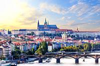 Prague city view with Manes bridge and Lesser Town with Prague castle on the background.