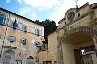 Town Hall Palace and Arch with Ancient Clock, Anguillara Sabazia, Lazio, Italy.