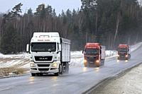 Salo, Finland - January 4, 2019: Fleet of three MAN semi trucks of Tomas Lotko, Czech Republic platooning on Finnish highway 52 on a day of winter.