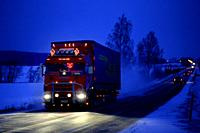 Salo, Finland - December 21, 2018: Beautifully customised red Scania semi trailer of VR Rantanen transports load on highway on a blue winter evening.