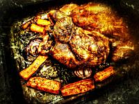 Golden crispy home cooked roast chicken with carrots and red onions