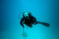 Diver under water, Maledives, Indian Ocean, South Asia.