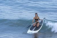Girl doing paddleboard, Alcocebre, Castellon province, Valencian Community, Spain.