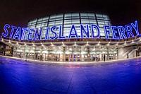 Staten Island Ferry - Nighttime wide view of the illuminated facade of the Staten Island Ferry. . . This image is available in color as well as in bla...