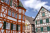 old half-timbered houses of the town Schiltach, Black Forest, Germany, historical guesthouse on the left.