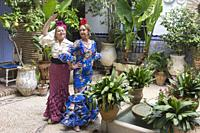 Women in traditional andalusian costume, Cordoba, Andalusia, Spain.