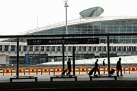 Seoul, South Korea, Asia - Travelers at Incheon International Airport with the train terminal in the backdrop.