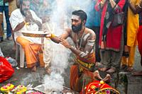 Singapore, Republic of Singapore, Asia - During the Thaipusam festival at the Sri Srinivasa Perumal Temple in Little India, a Hindu devotee is prepari...