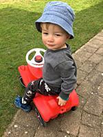 Boy, 2 years old, on a toycar in Ystad, Scania, Sweden.