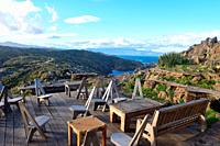 chairs on the terrace of the restaurant of Cap de Creus, Gerona province,Catalonia, Spain (background Cala Culip).