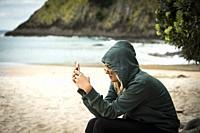 Woman, 23, on a beach in Coromandel, New Zealand.