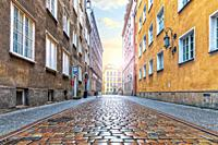 Empty european street with pebble stone pavement in the downtown of Gdansk, Poland.