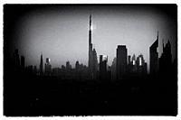 Black and white image of burj Khalifa among skyscrapers of Dubai city.