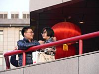 Xi'an China A couple standing on a balcony.