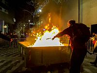 Tilburg, Netherlands. Container on Fire after disposing last torches at a torch procession for peace finish, pondering all the Christmas wishes on the...