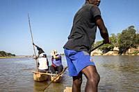 Canoe ride on the Manambolo river, in the Tsingy de Bemaraha National Park. Madagascar, Africa.