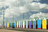 Colourful beach huts on Brighton and Hove seafront in East Sussex, England.