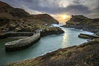 The entrance to the harbour at Boscastle, on the north coast of Cornwall. Captured from a high vantage point, at sunset in early March.