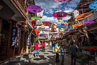 Colourful umbrellas hanging in a historical street in Dali Old Town, Yunnan province, China.