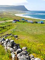Settlement and beach at Hvallatur. The remote Westfjords (Vestfirdir) in north west Iceland. Europe, Scandinavia, Iceland.