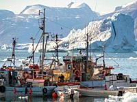 The harbour. The town Uummannaq in the north of West Greenland, located on an island in the Uummannaq Fjord System. America, North America, Greenland.