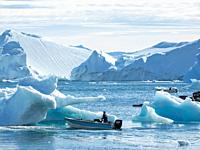 Fishing boats entering the harbour. The town Uummannaq in the north of West Greenland, located on an island in the Uummannaq Fjord System. America, No...