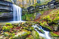 Waterfall in a beechwood. Portillo de la Sia Pass. Cantabria, Spain, Europe.