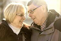 senior couple in sunlight looking at each other, in Cottbus, Brandenburg, Germany.