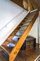 Pinewood Miller's stairs leading from living room to upstairs floor inside an old circa 1760 Canadiana fieldstone cottage style house